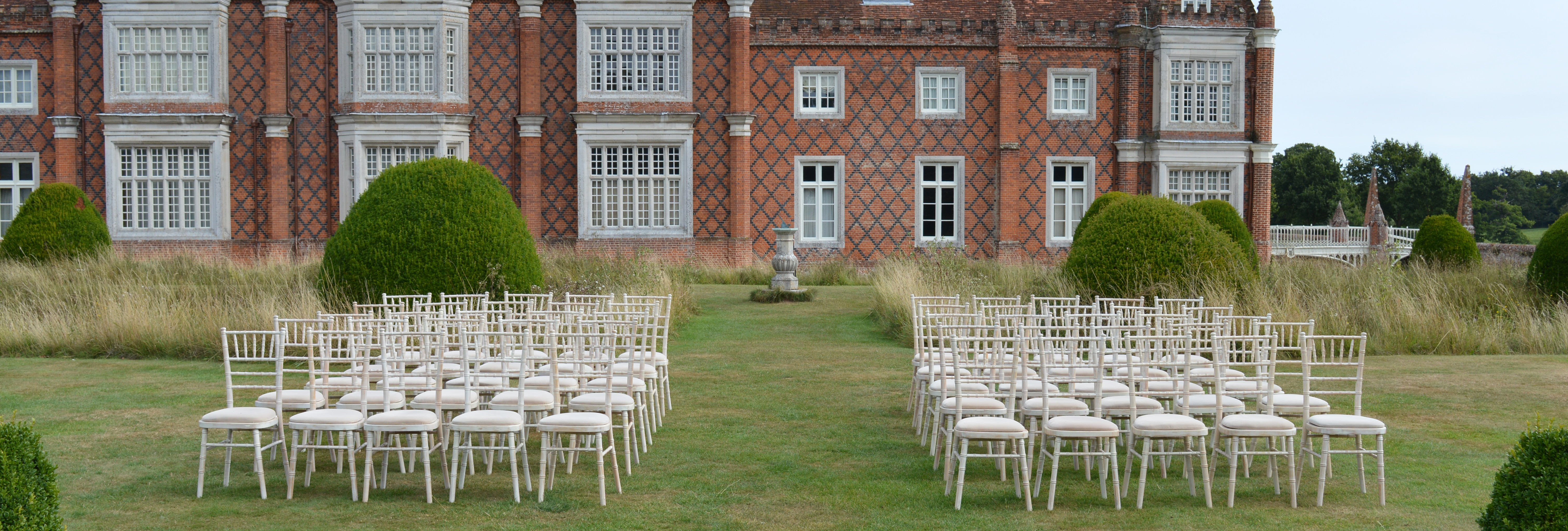 white lime wash chiavari chairs for a wedding at hintelsham hall suffolk