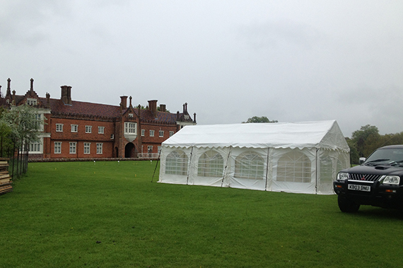 party tent on lawn at helmingham hall suffolk