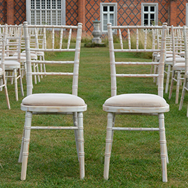 white lime wash chiavari chairs Helmingham Hall Weddings - Wedding Venue